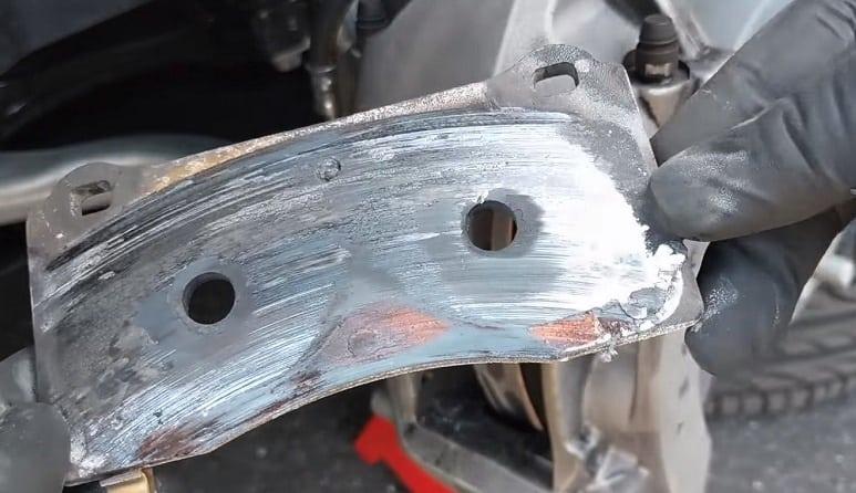 worn brake pad grinding on rotor